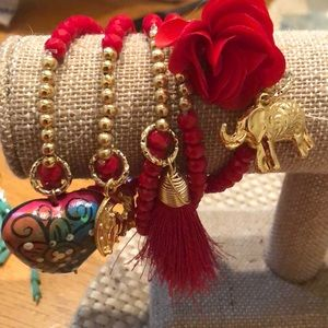 Five red and gold bracelets With embellishments